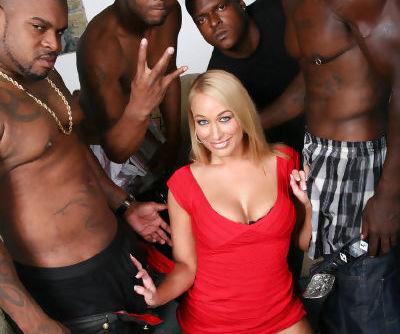 Smiley blonde Mellanie Monroe takes on three big black cocks for a cum facial