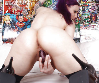 Fetish model Vellocet puts her hair in pigtails before getting naked