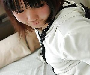 Asian teen Chihiro Tanabe undressing and spreading her pussy lips in close up