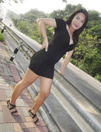Brunette teen Asian ladyboy Pu showing her tits and posing in public