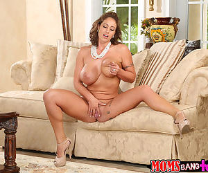 Tattooed brunette Eva Notty is playing with her awesome big boobs