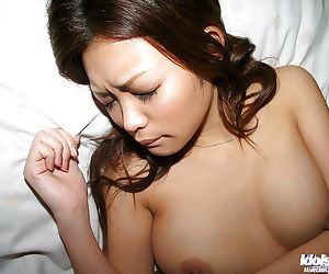Cuddly asian doll with nice tits stripping and taking bath