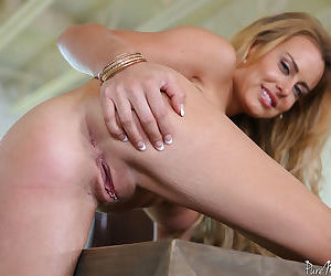 Busty blonde MILF Corinna Blake expose her toned and fit mature body