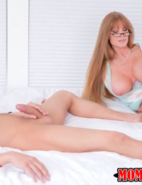 Busty mature woman in glasses Darla Crane favors a young guy with a blowjob