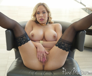 Passionate mature chick Olivia Austin draws attention to her gaping snatch