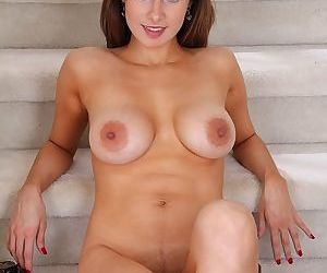Busty mom Carla undresses to masturbate shaved pussy in high heels
