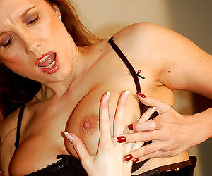 Horny mature lesbian ladies dressed up in kinky lingerie and started playing with their favorite strapon toys.