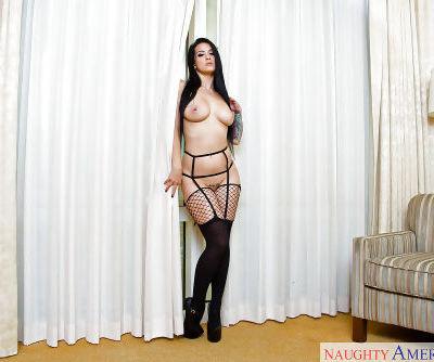 Tattooed brunette babe Katrina Jade strutting in fishnet stockings