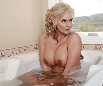 Phoenix Marie shown in close up while taking a hot bath naked