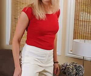 Hot older blonde Charli Shay posing fully clothed in business clothes