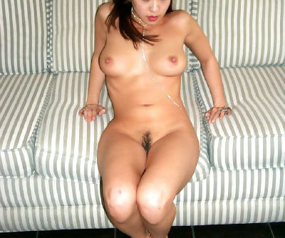 Oriental beauty Milla showing off all natural tits and trimmed cunt on couch