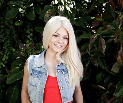 Cute blonde girl Elsa Jean takes off her denim clothes to pose nude in garden