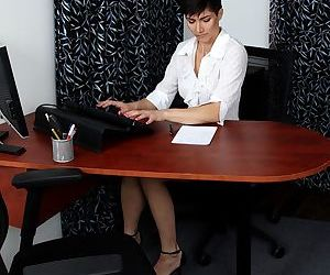 Hot sexy brunette Halle B. shows her skinny long legs in the office