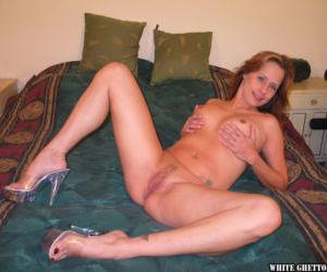 Beauty mature Sherri Parker is lying and masturbating her opened puss