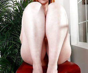 Chubby older redhead Marie McCray spreading hairy mature pussy