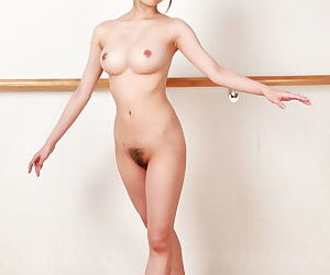 Young Asian dancer Ririka Suzuki stretches nude in studio to bare trimmed muff