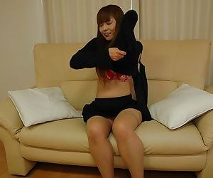 Frisky asian MILF slipping off her clothes and exposing her juicy cunt
