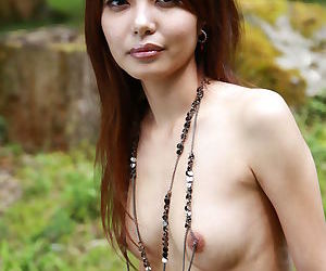 Sassy Asian Sakurako stripping by the river to flaunt tiny tits & hairy muff