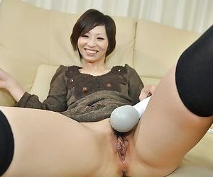 Sexy asian MILF Chiaki Sugai gets her hairy cunt vibed and strips down