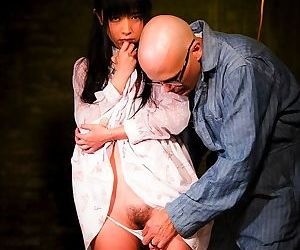 Japanese pornstar Marica Hase gets tied up with rope in a poorly lit cellar