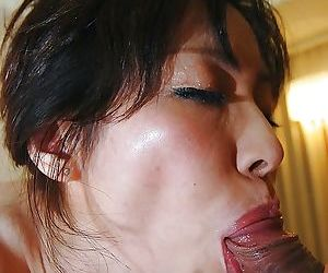 Lusty asian MILF Mayumi Miyazaki gets fucked and takes cum on her face