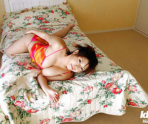 Big busted asian babe Mai Haruna stripping off her clothes