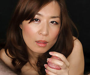 Pretty Japanese woman licks cum from fingers after sucking POV