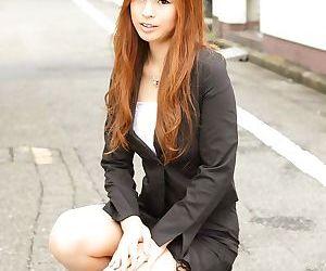 Stunning Asian girl Rina Kikukawa poses seductively fully clothed outoors