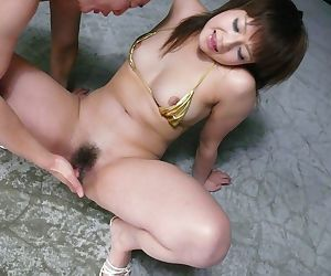 Submissive Japanese bitch in golden bikini Kurara Iijima gets toyed up