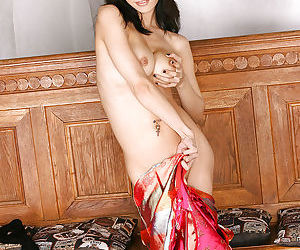 Adorable asian babe slowly stripping off her clothes and spreading her legs