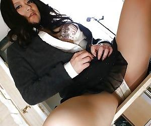 Shy asian MILF in dress clothes undressing and exposing her hairy gash