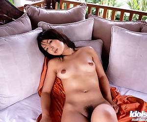 Tempting asian gal with hairy pussy Bunko Kanazawa posing naked