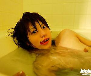 Asian babe in lingerie Hitomi Hayasaka stripping and taking bath