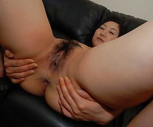 Sassy asian MILF Risa Okamoto getting naked and spreading her legs