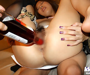 Filthy asian lady gets her hairy twat stuffed with a vibrator and a bottle