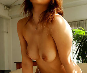 Busty asian hottie Sumire posing topless in sexy white panties