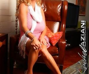 Hot older blonde Rachel Aziani reveals her bald pussy and huge boobs