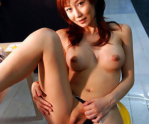 Sweet asian babe Yuri Seto uncovering her perky tits and unshaven cunt