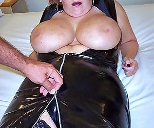 Busty Curvy Claire in latex sucks- licks and strokes with massive melons bared
