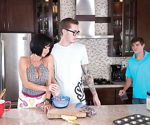 Buxom cougar Veronica Avluv stroking a young studs massive penis