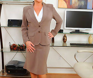 Classy business lady Ginger Lynn masturbates her horny twat in her office