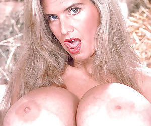 Older blonde broad Busty Dusty unleashing monster boobs in boots