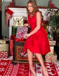 White female Natalia Forrest pulls on nylons and heels at Christmas