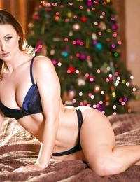 Solo girl Karlie Montana removing bra and panty set in front of Xmas tree