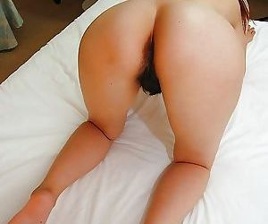Pretty asian babe Natsuko Miyamoto toying her hairy slit after shower