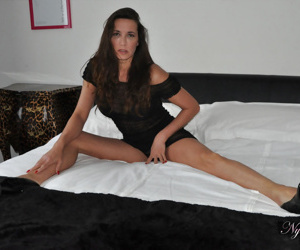 Sexy older Nylon Jane in black sheer lingerie spreading legs in high heels