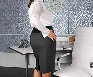 Fully clothed business woman flashes her bra and bare ass at her desk