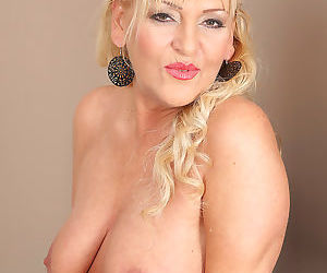 Busty hot mature Sissy shows her hard nipples & spreads for pussy closeup