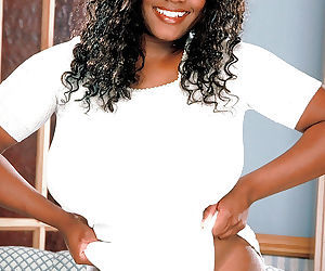 Ebony mom Sammie Black unleashing massive black tits and hairy pussy