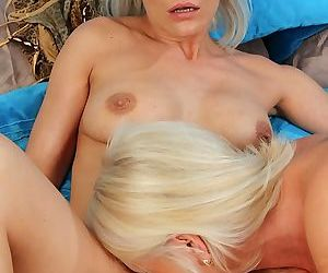 Older lesbian lovers Iris and Vanessa Moore licking and fingering pussies